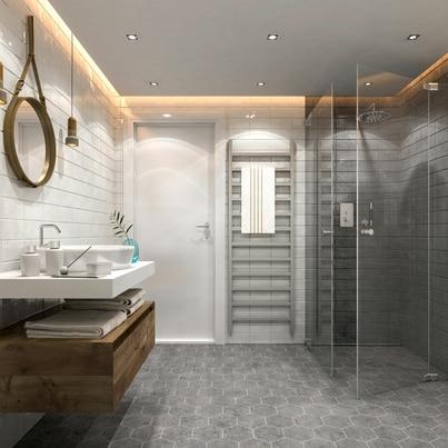 Szarości i drewno w małej łazience