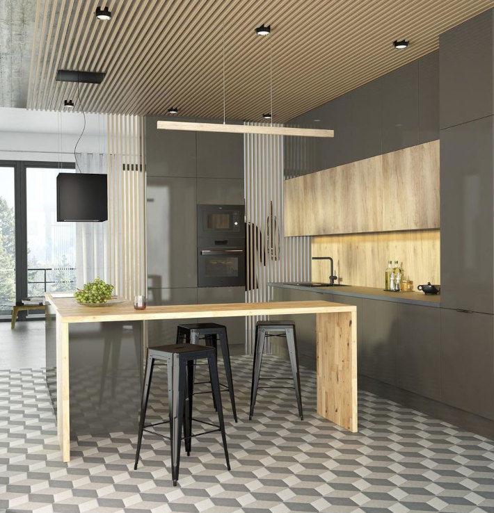 Nowoczesna kuchnia, w której dominuje kolor grafitowy, przełamany elementami z naturalnego drewna